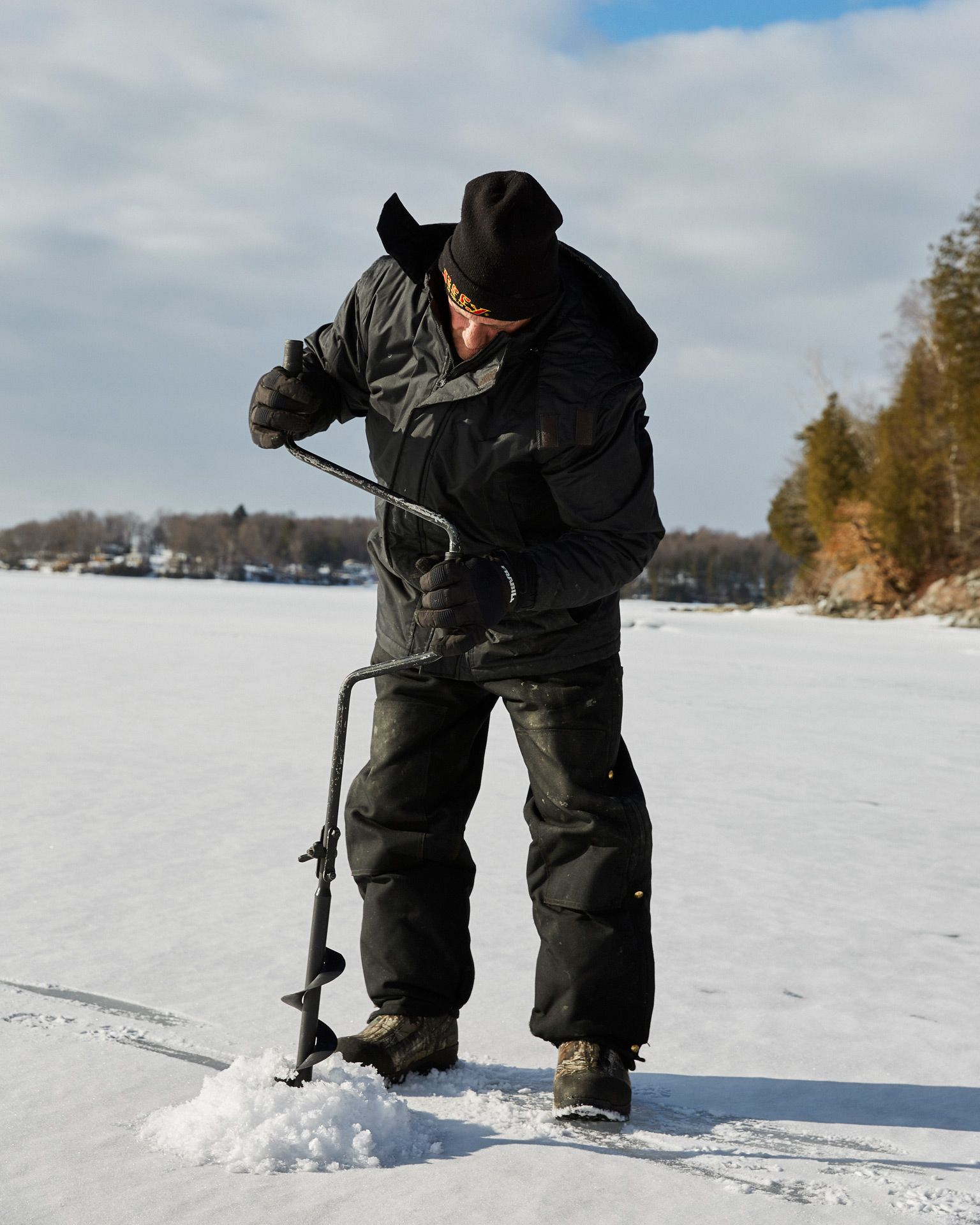 fisherman making hole in a frozen lake by Oumayma B Tanfous for short film Popper Fly