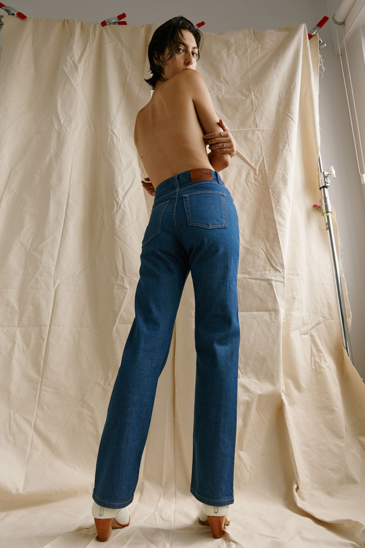 Premiere Adresse high fashion shop photographs by Kelly Jacob of woman model topless wearing high-waisted blue pants