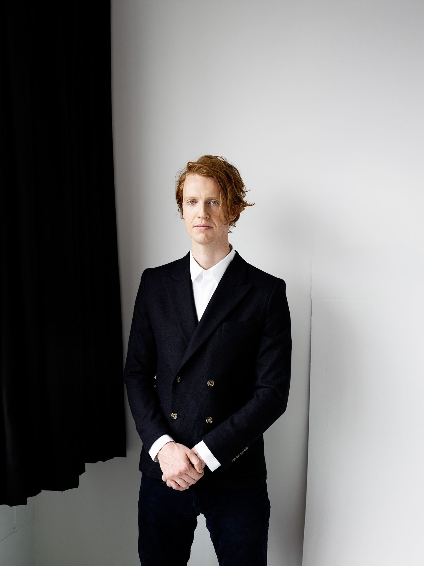 simple portrait of Richard Reed Parry ginger male standing looking at camera by Guillaume Simoneau