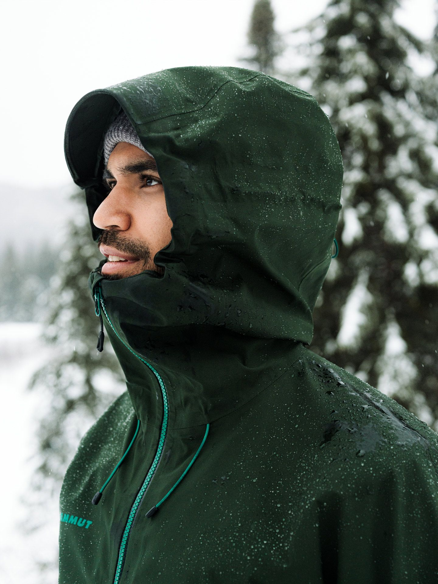 Sail sports gear photographed by Alexi Hobbs of man wearing water-repellent forest green jacket