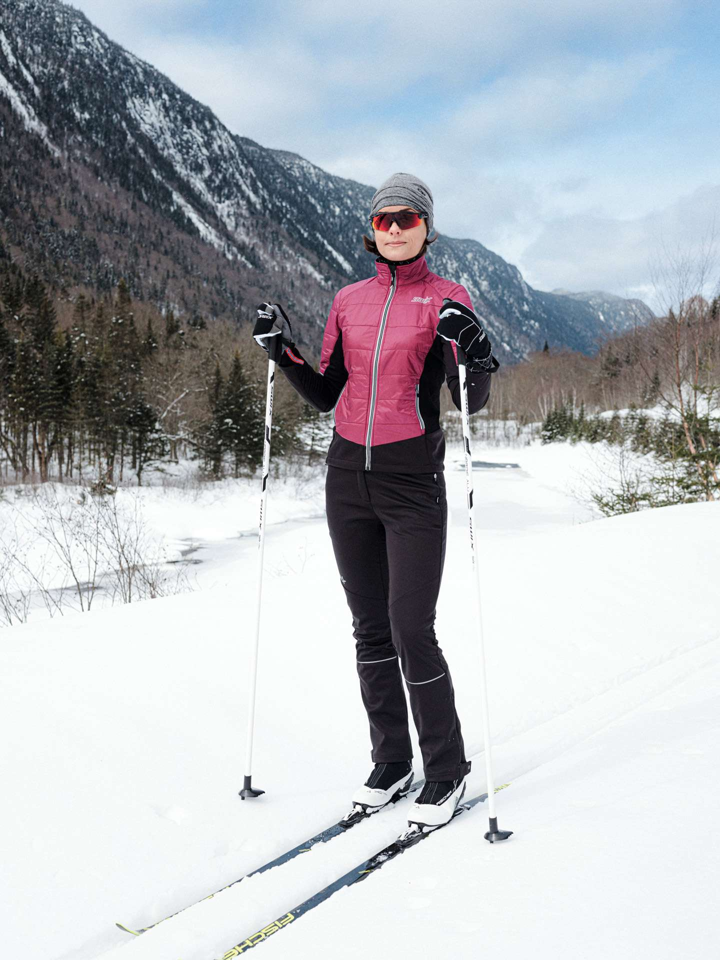 Sail sports gear photographed by Alexi Hobbs of woman in pink cross-country skiing gear