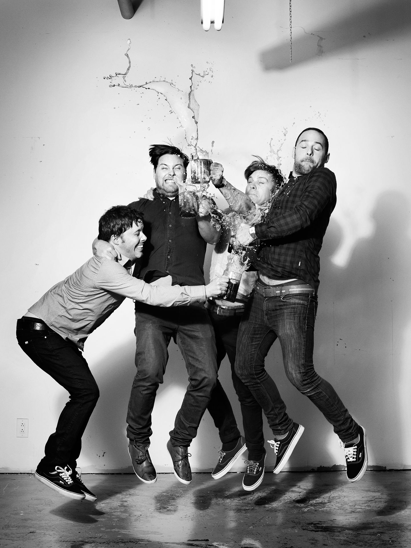 Les Trois Accords music group photographed jumping in the air by Jocelyn Michel for JUMP personal series