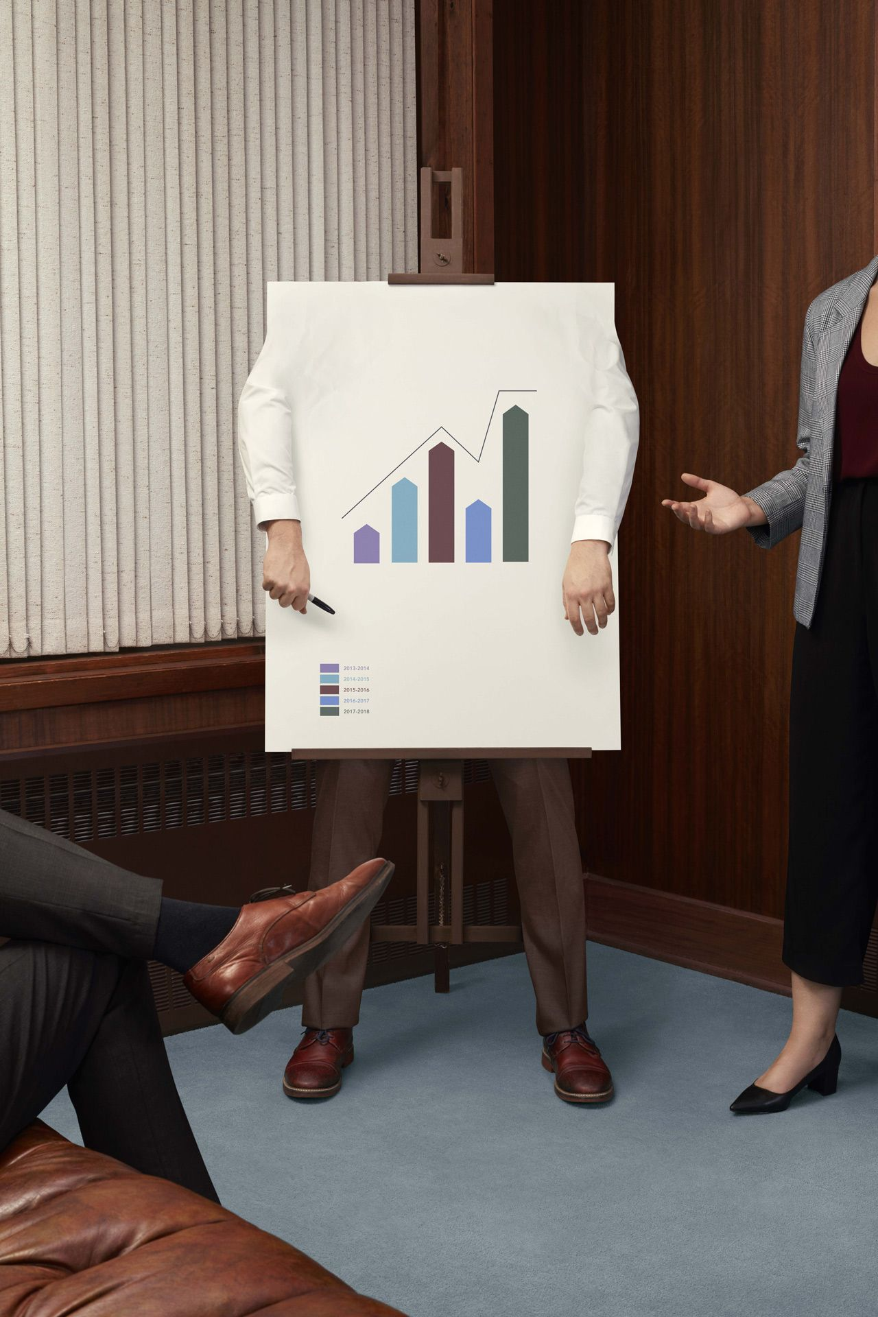 person disguised as a drawing board surrounded by other people by Simon Duhamel for Berlitz and Rethink