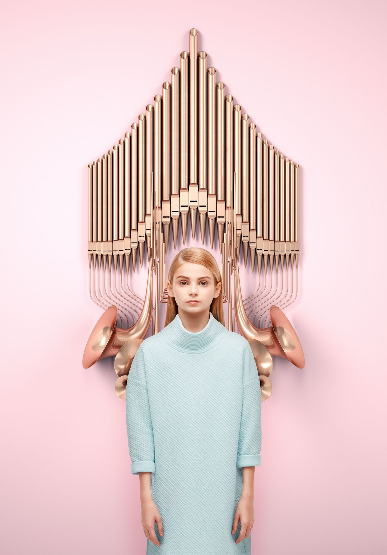 young blonde girl wearing light blue dress standing in front of futuristic copper pipes and horns by Simon Duhamel for creative project Bloom Maestro