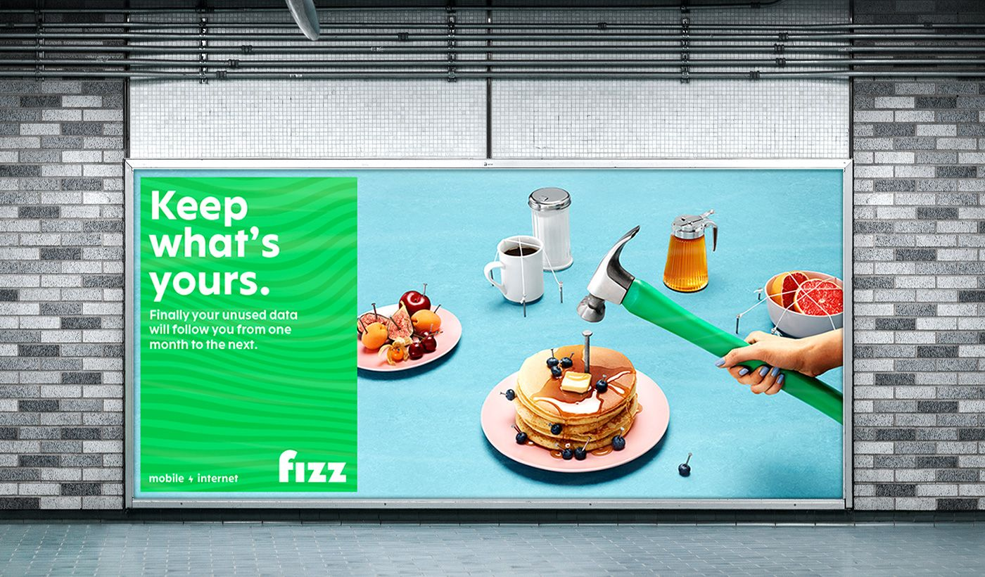 Fizz brand launch poster by Simon Duhamel in the metro hammer nailing pancakes to the table