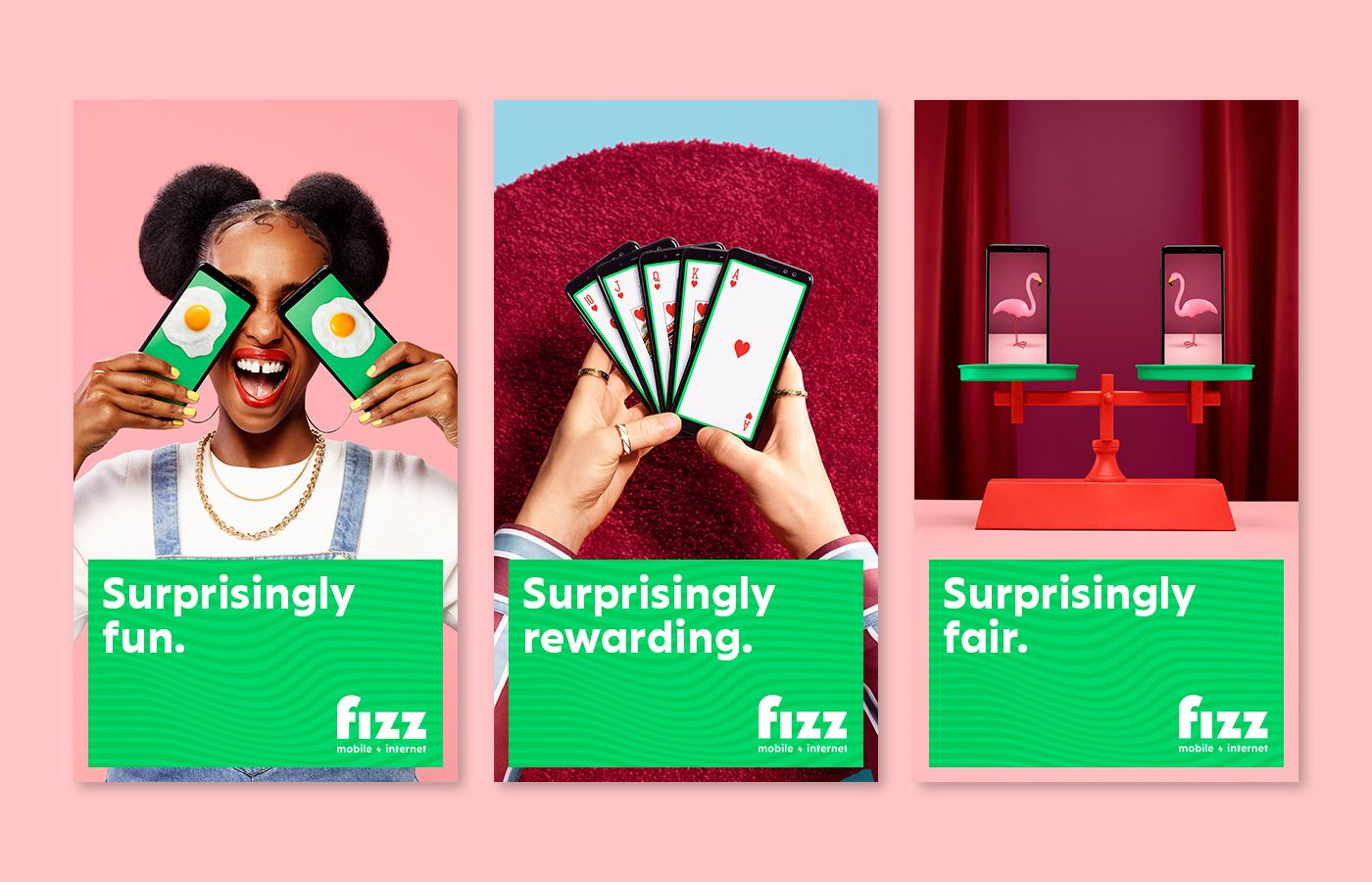 layout of posters of Fizz brand launch by Simon Duhamel with Ogilvy hands holding phones displaying game cards scale wighting flamingos
