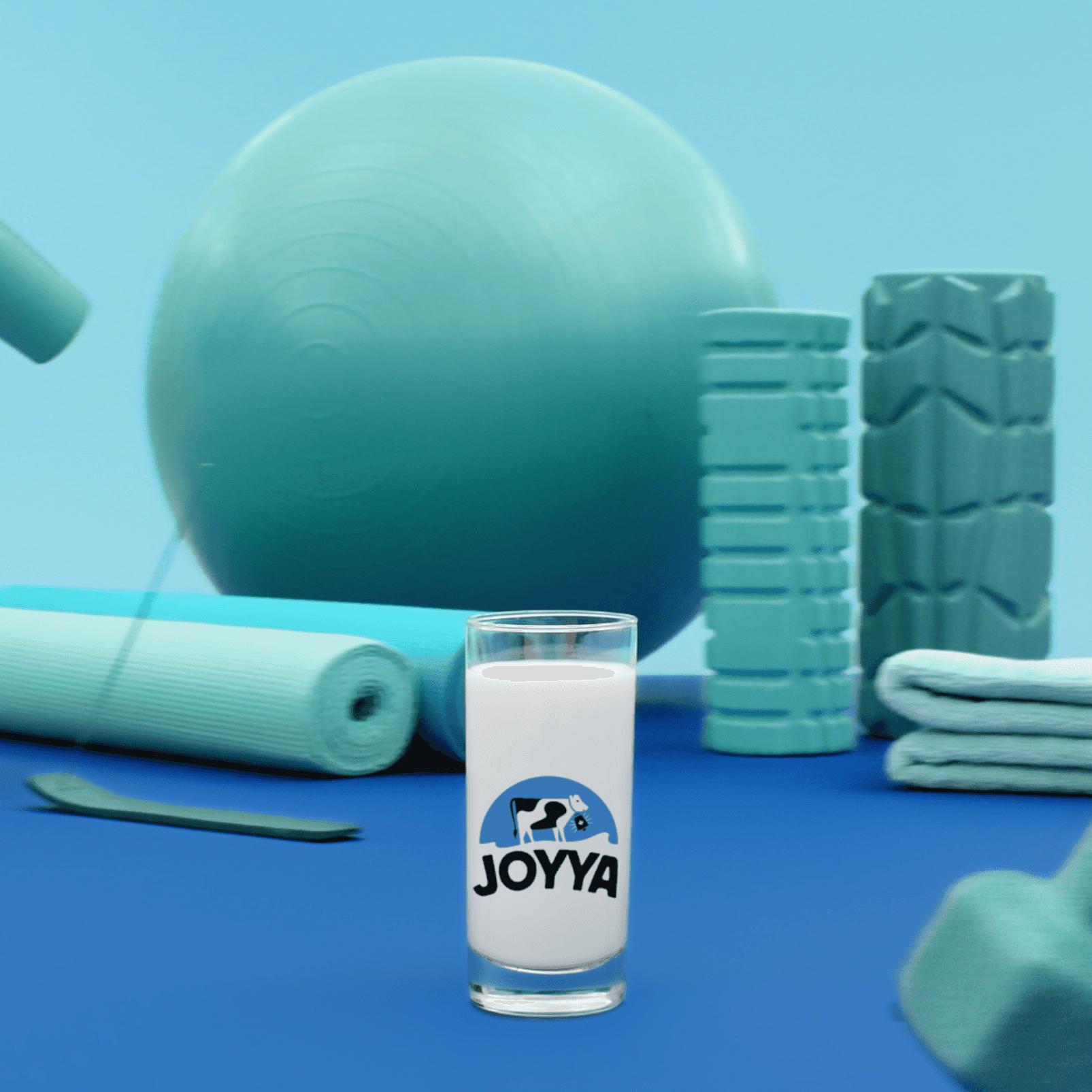 glass of Joyya proteined milk in front of yoga equipment by Simon Duhamel for Cossette