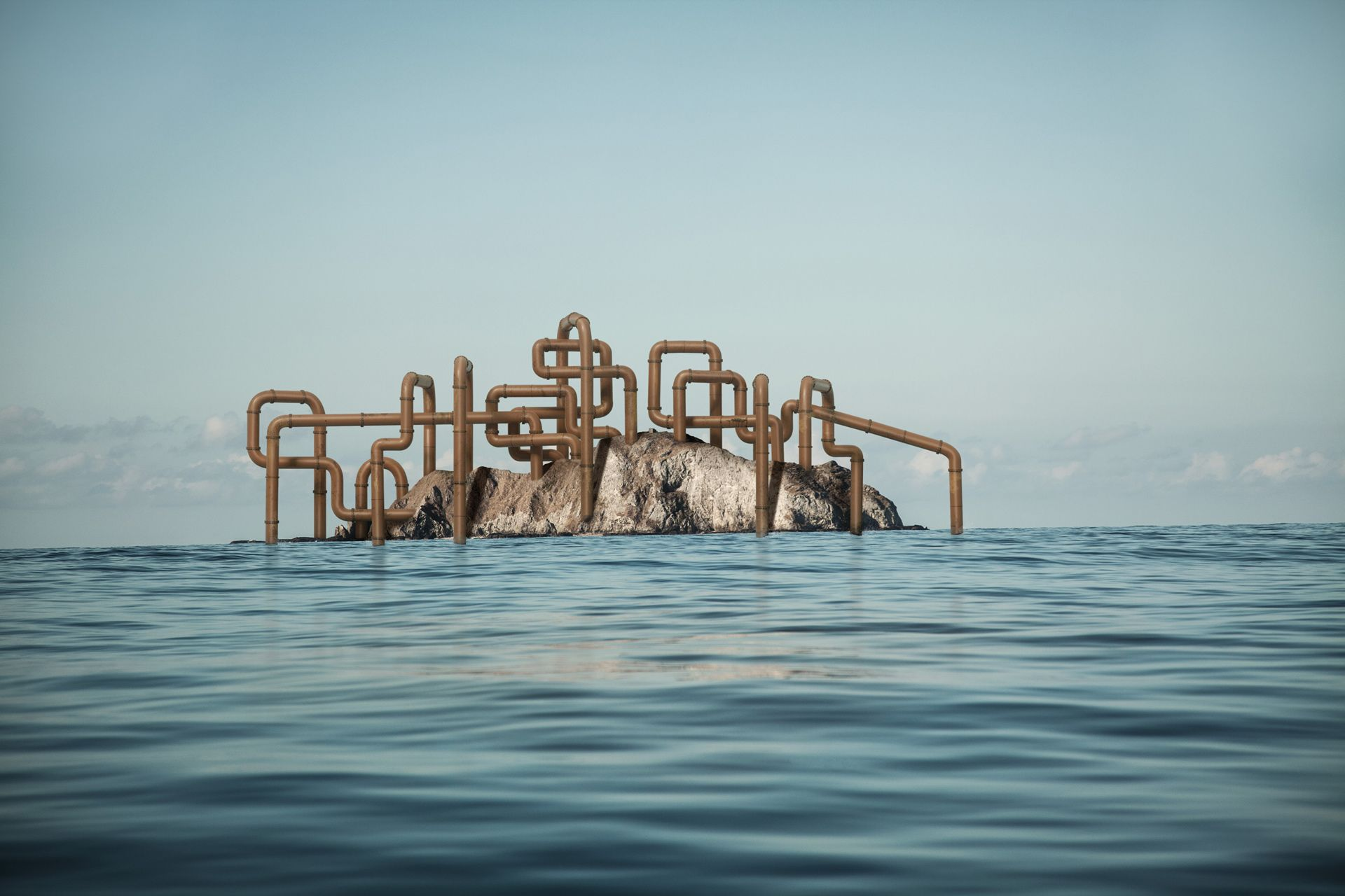cluster of pipelines going through a rock in middle of ocean by Simon Duhamel for Pipeline