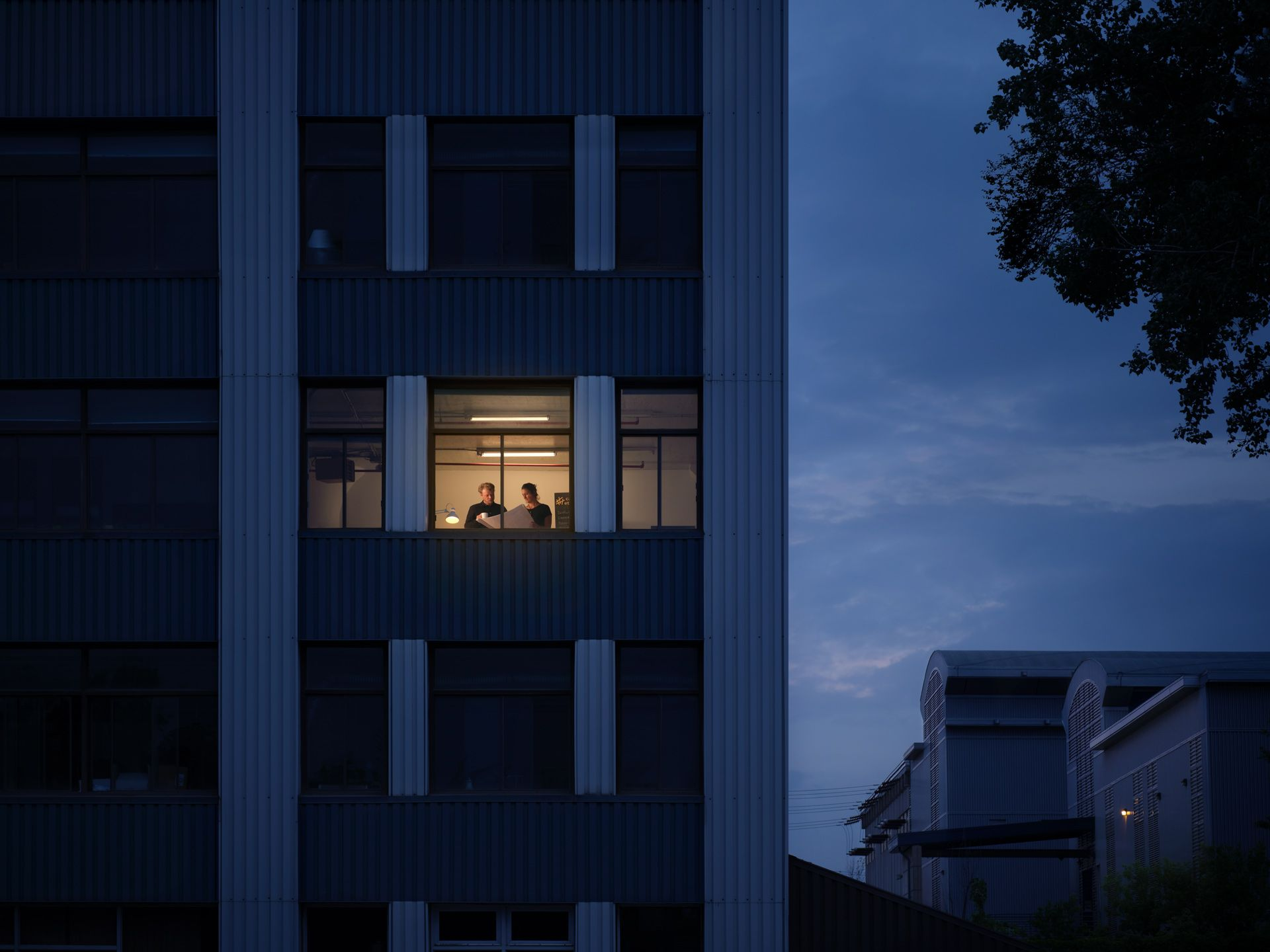 view inside Castor headquarters at night with two people working inside photographed by Simon Duhamel for PME MTL in collaboration with K72