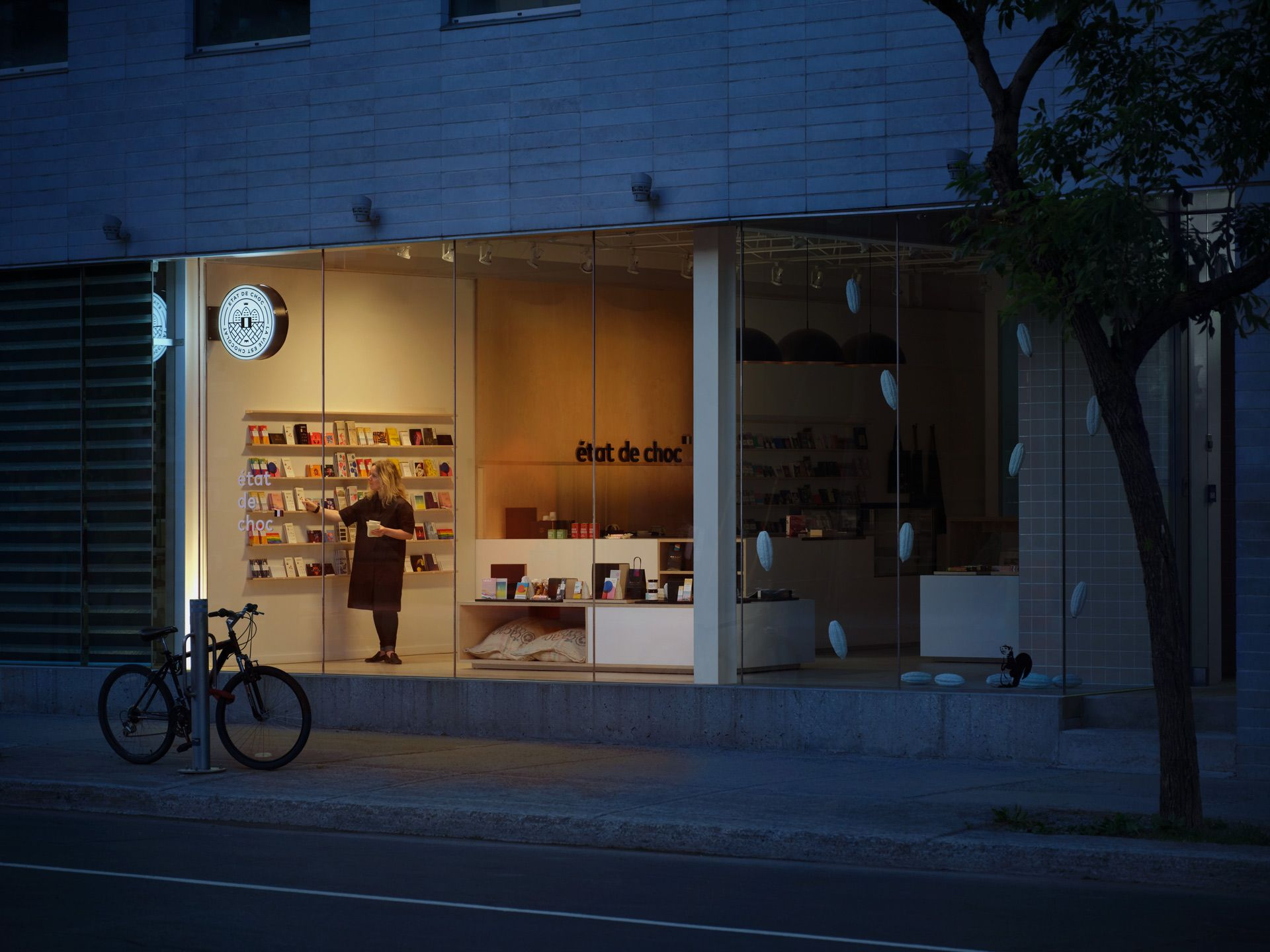 view inside library Etat de Choc at night with one person working inside photographed by Simon Duhamel for PME MTL in collaboration with K72