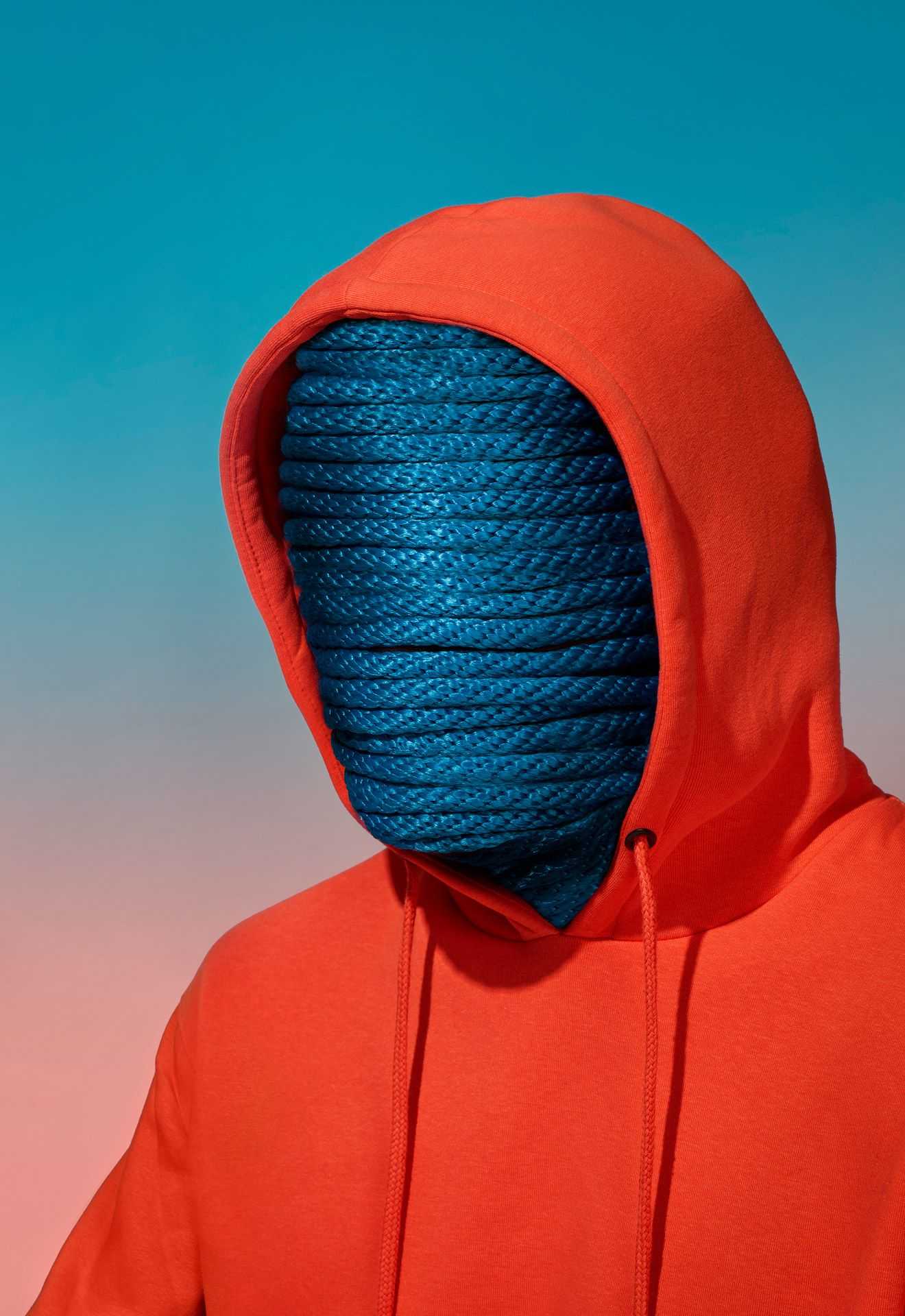 man face covered in blue rope wearing red hoodie by Simon Duhamel for creative project SAND