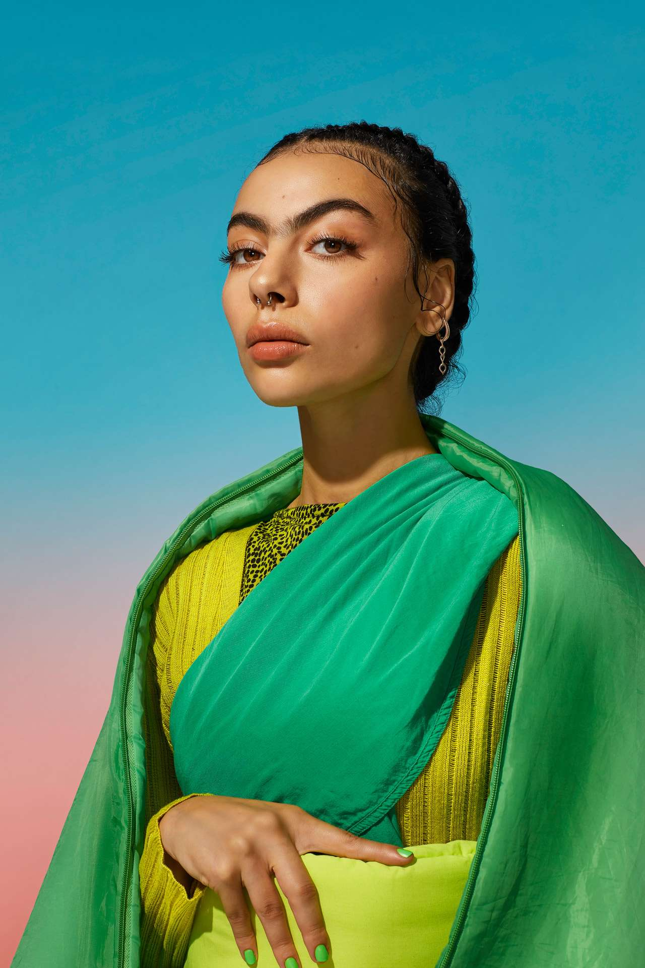 woman of indian origin looking at camera in layered pieces of green fabric giving a sari feel by Simon Duhamel for SAND