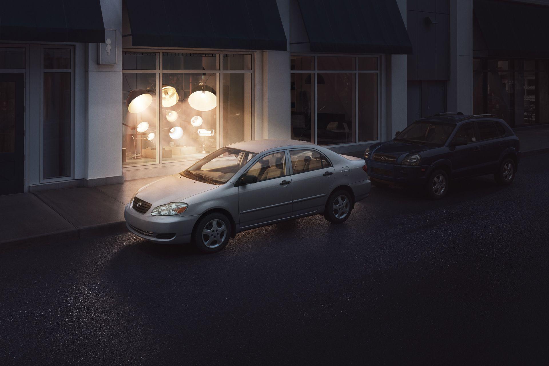 lights in a lamp shop bending to illuminate a grey car by Simon Duhamel for Sherlock