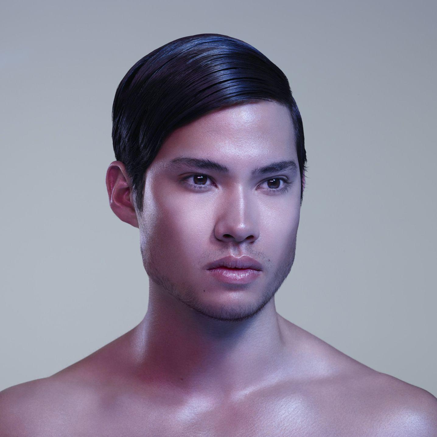 asian man slicked hair light beard light pink background soft coloured lights by Simon Duhamel for Skintone