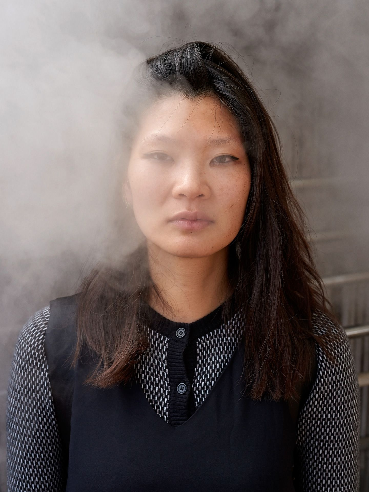 portrait of asian girl Shammy light steam around face looking at camera by Guillaume Simoneau