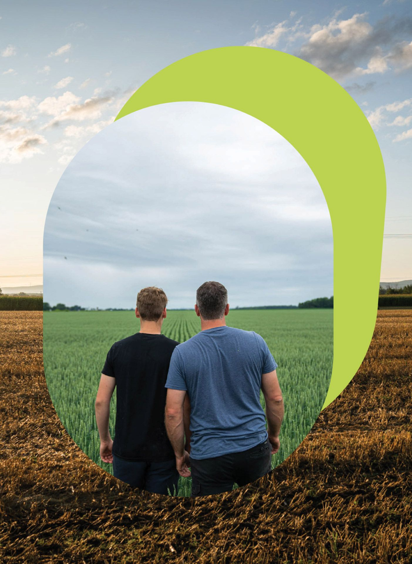 father and son looking out to the fields by Bruno Florin for Sollio Agriculture