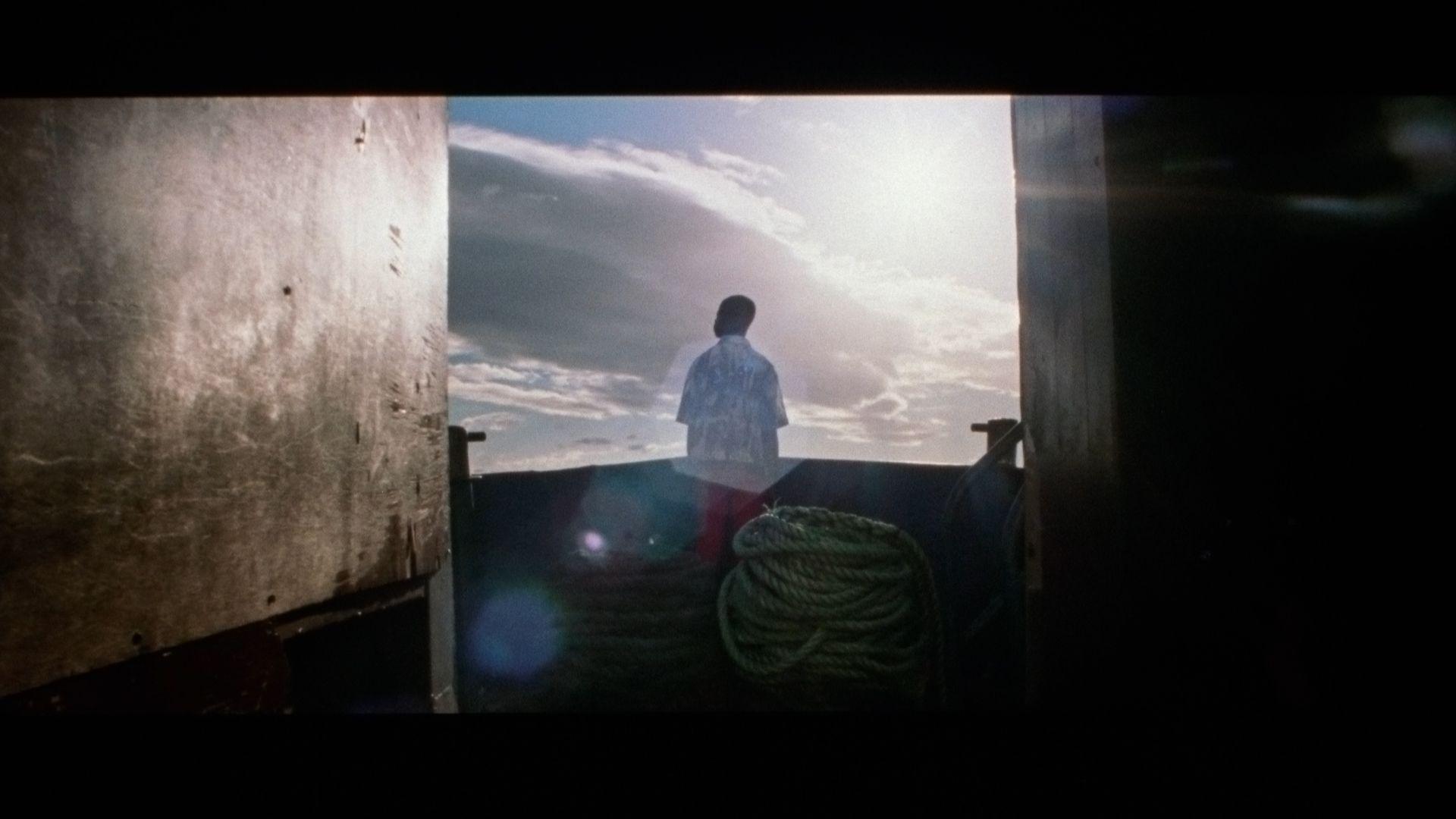 singer Karim Ouellet on a boat for his music video of La Mer A Boire filmed by Les Gamins