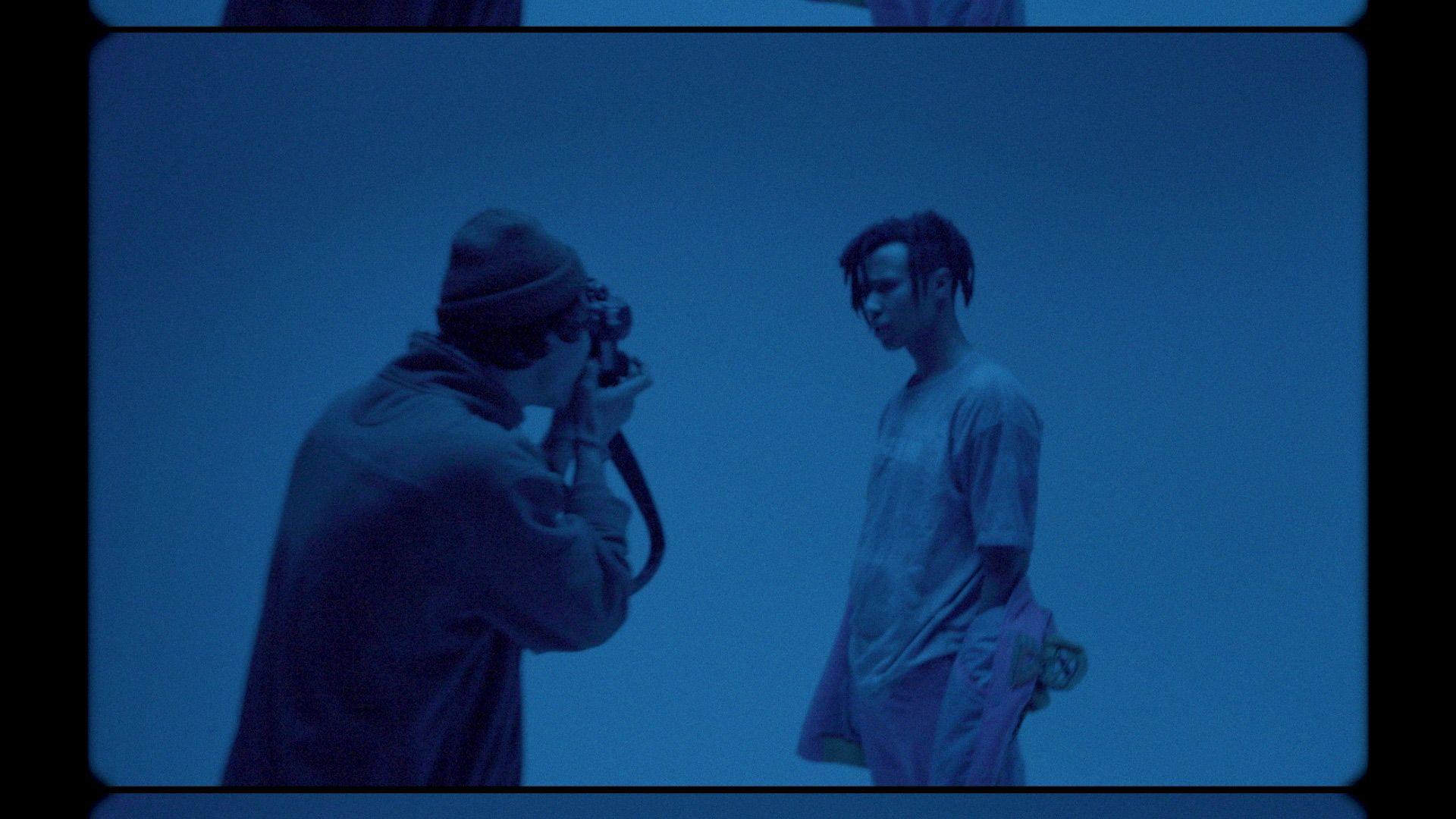 rapper Zach Zoya in blue lighting for music video Who Dat filmed by Les Gamins