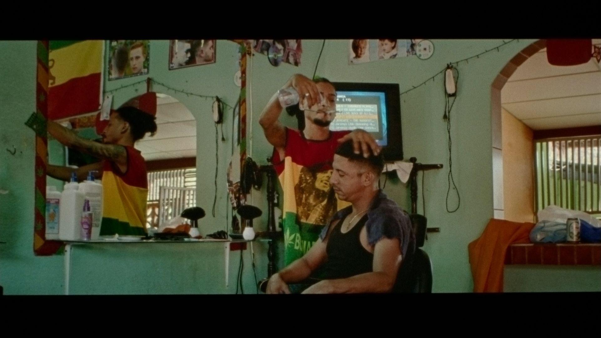 hairdresser working on man's head for singer Karim Ouellet music video of La Mer A Boire filmed by Les Gamins