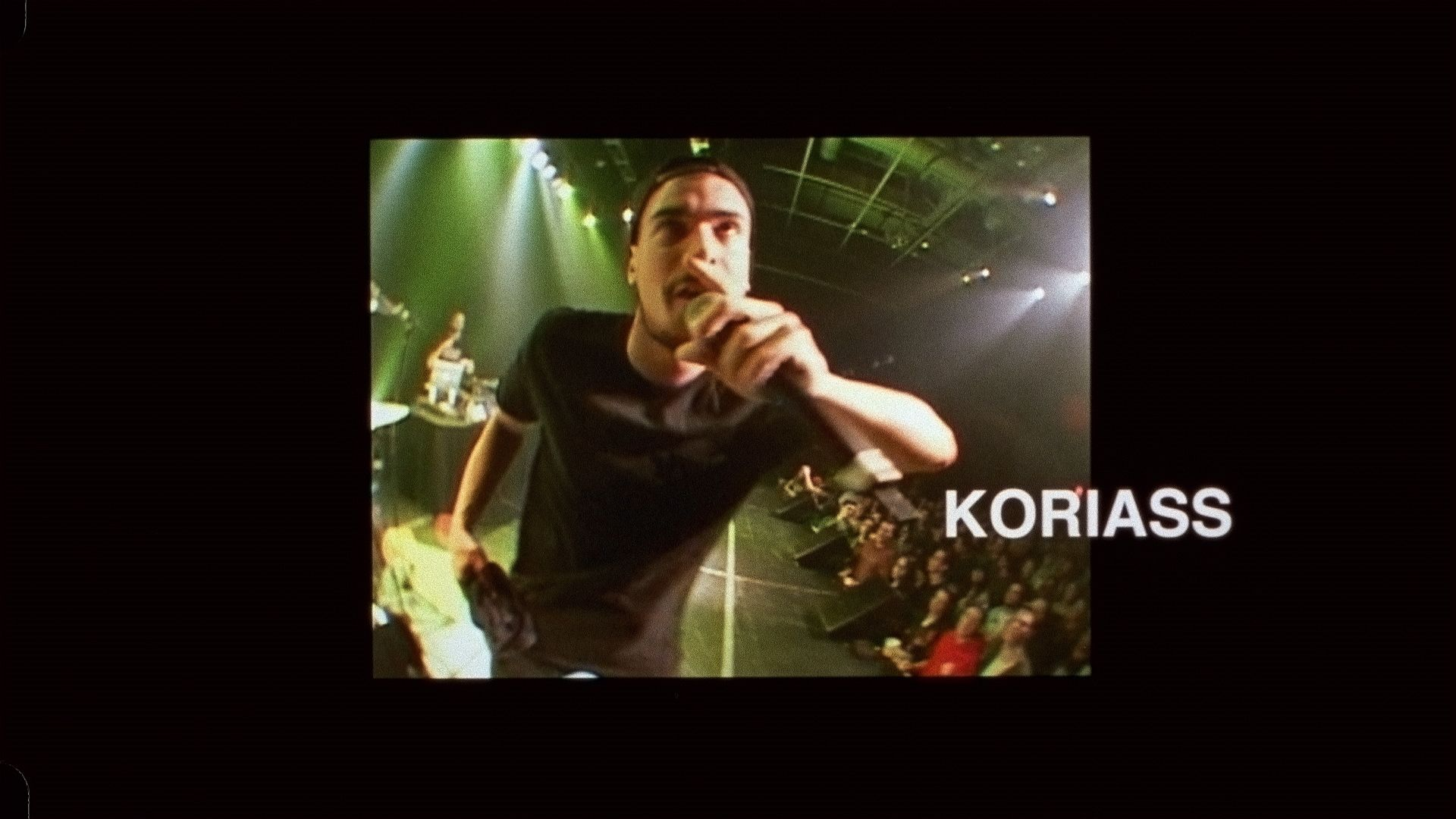 rapper Koriass singing on stage making faces for L'Osstidfilm documentary filmed by Vincent Ruel-Cote from Les Gamins about L'Osstidtour