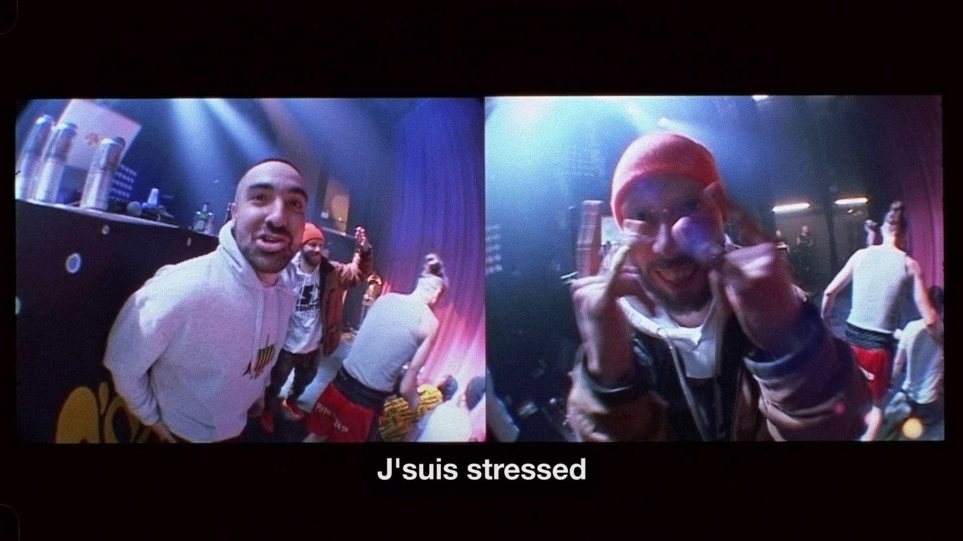 Alaclair Ensemble bandmates being silly in front of camera on stage saying they're stressed for L'Osstidfilm documentary filmed by Vincent Ruel-Cote from Les Gamins about L'Osstidtour