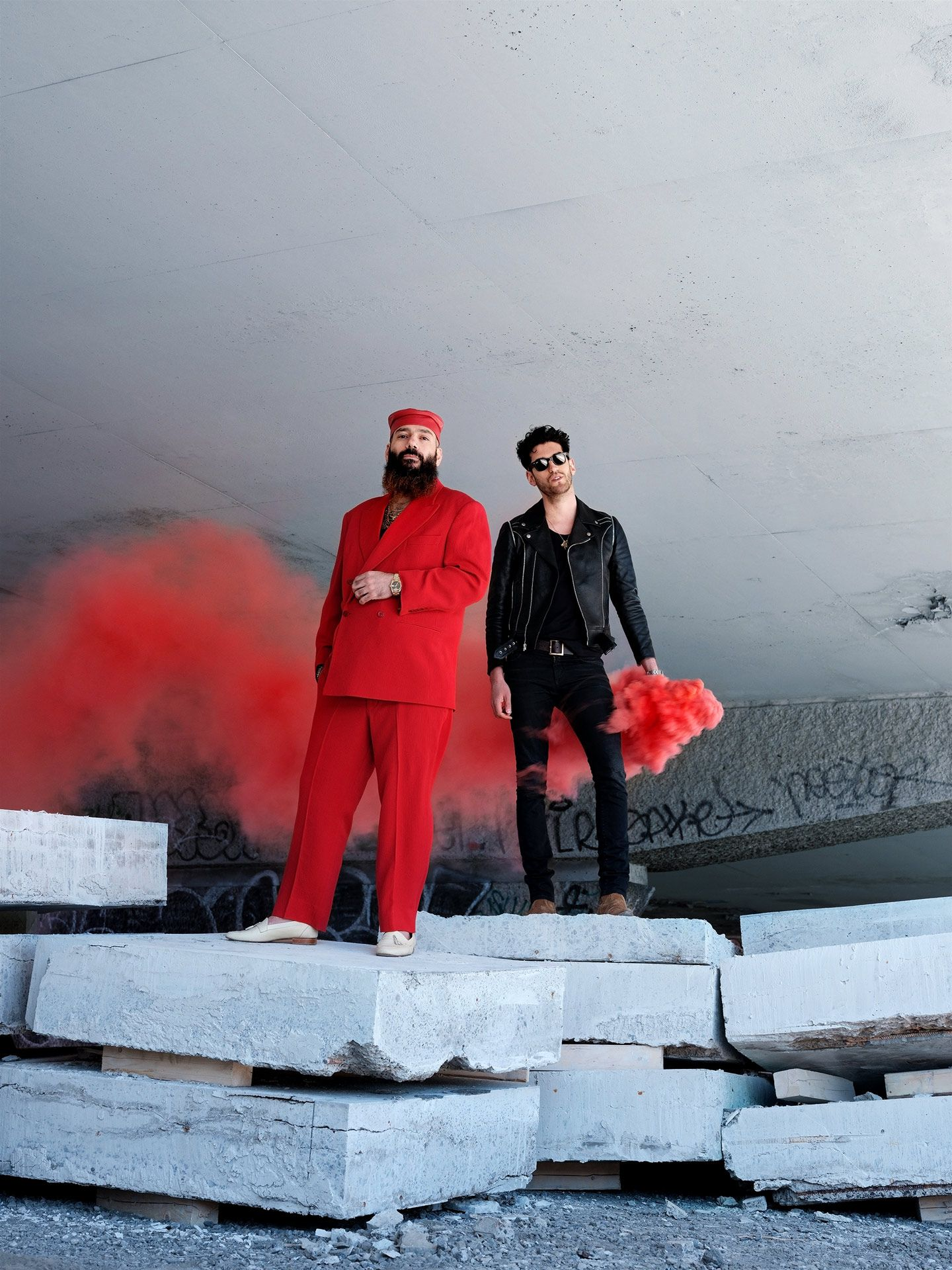 Chromeo Funklordz portrait male group duo music editorial outside smoke on cement block using red smoke bombs photographed by Guillaume Simoneau for Voir cover magazine documentary summer