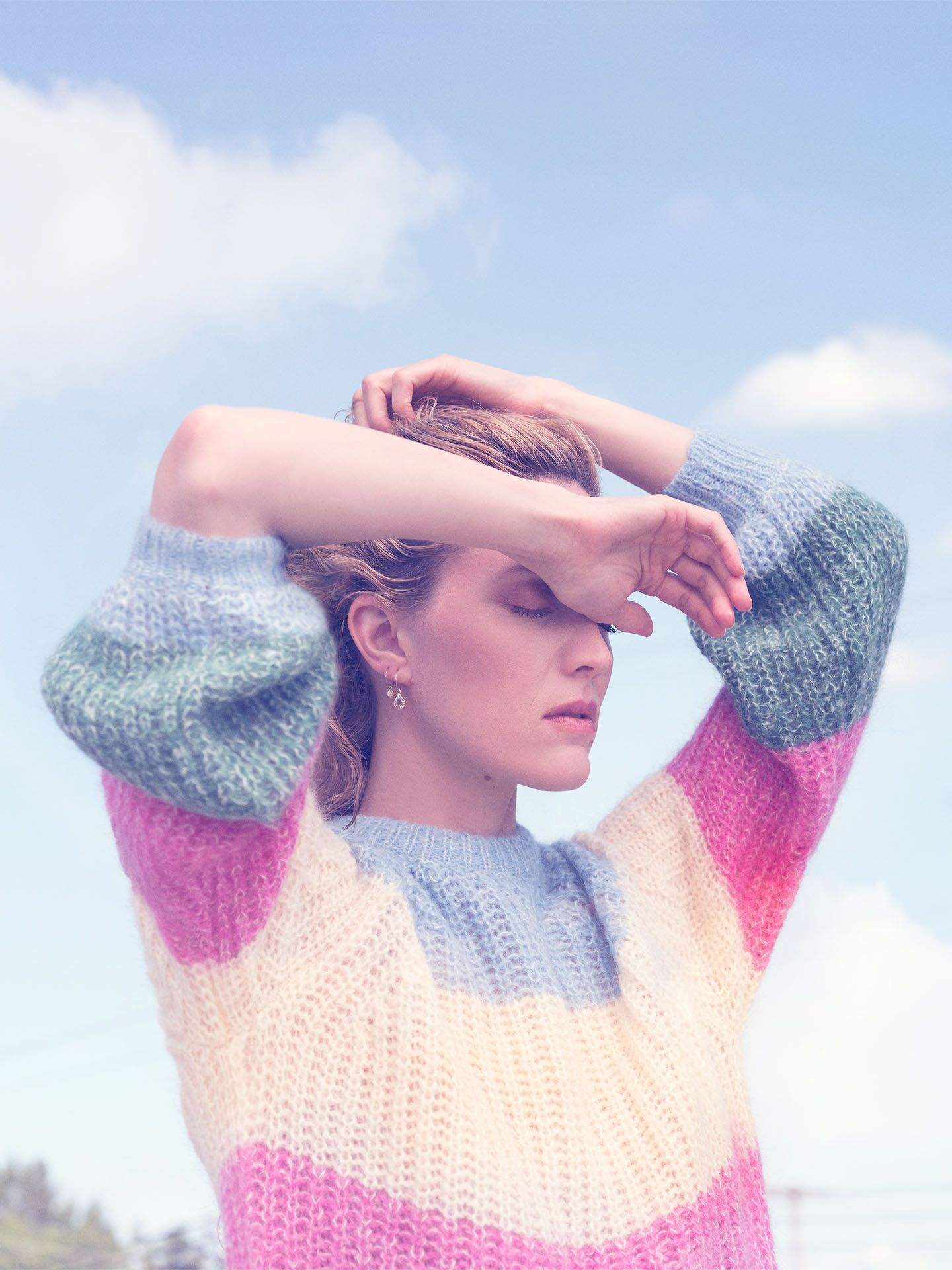portrait of Evelyne Brochu in pastels colours eyes closed arms above her head by Jocelyn Michel for Voir