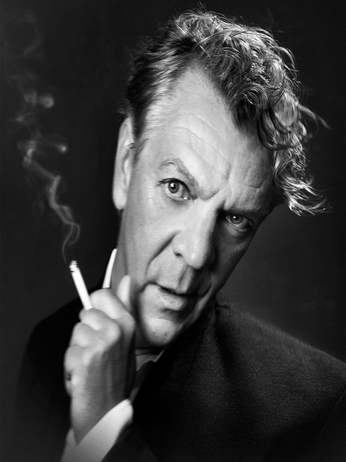 black and white distorted portrait of Marc Labreche holding a cigarette by Jocelyn Michel for Voir
