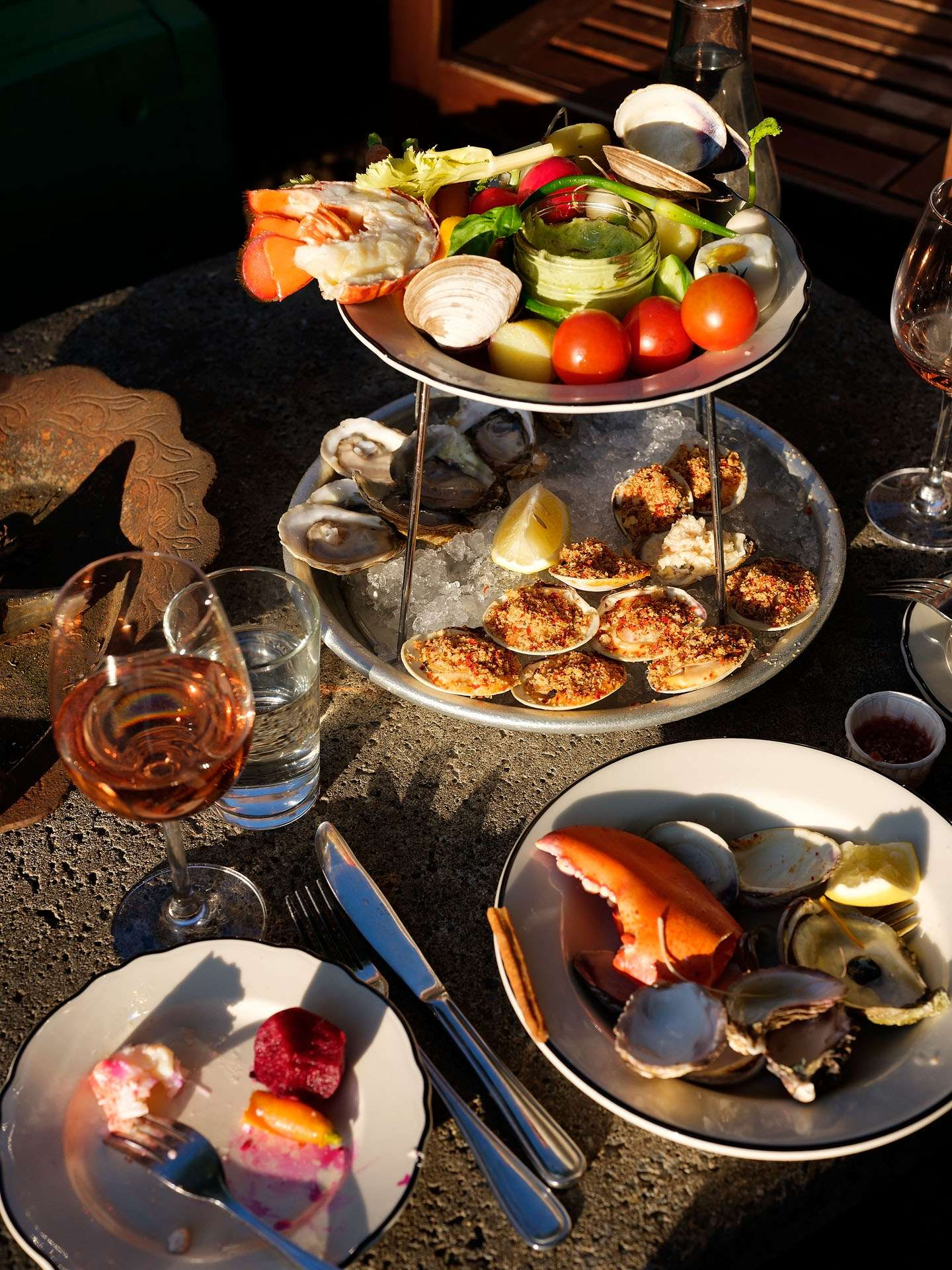 platers of seafood and oysters photographed by Guillaume Simoneau as part of Off Duty Montreal series for The Wall Street Journal magazine