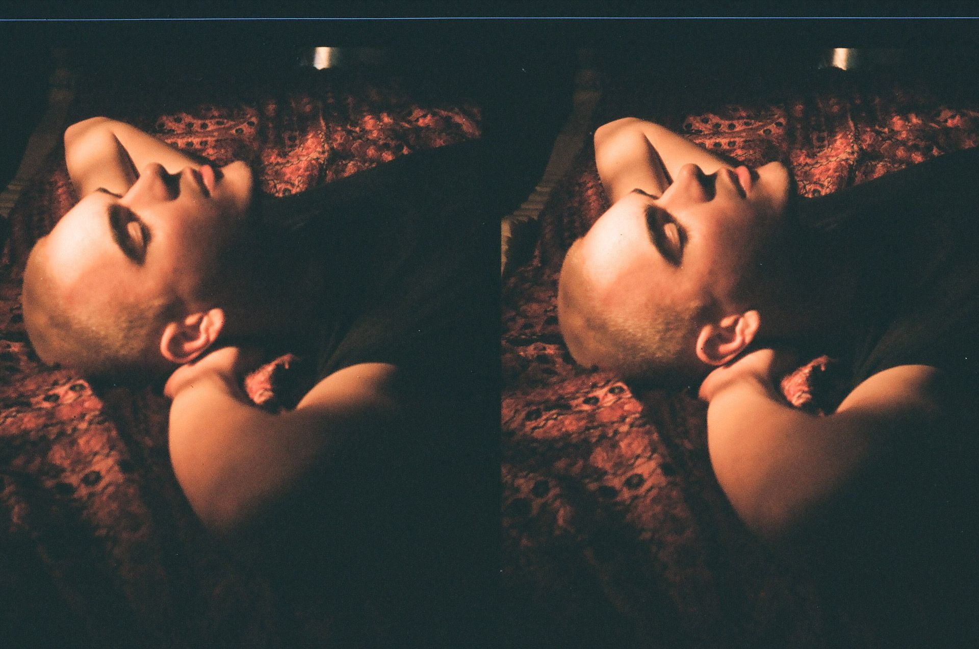 singer Yuki Dreams Again laying on fabric with hands behind his head in his promotional video filmed by Les Gamins