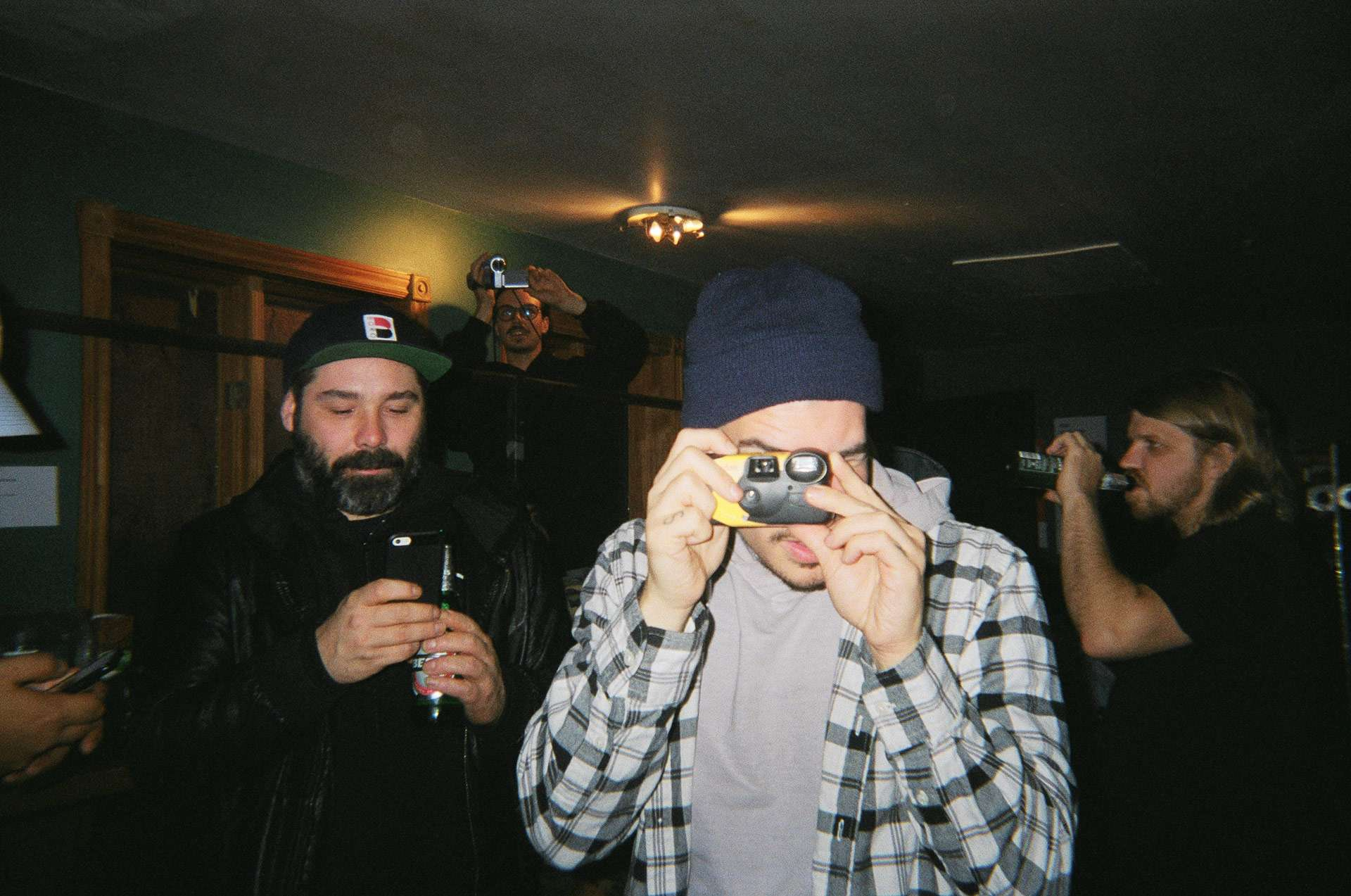 rapper Koriass taking picture with disposable camera in behind the scenes of L'Osstidfilm documentary filmed by Vincent Ruel-Cote from Les Gamins about L'Osstidtour