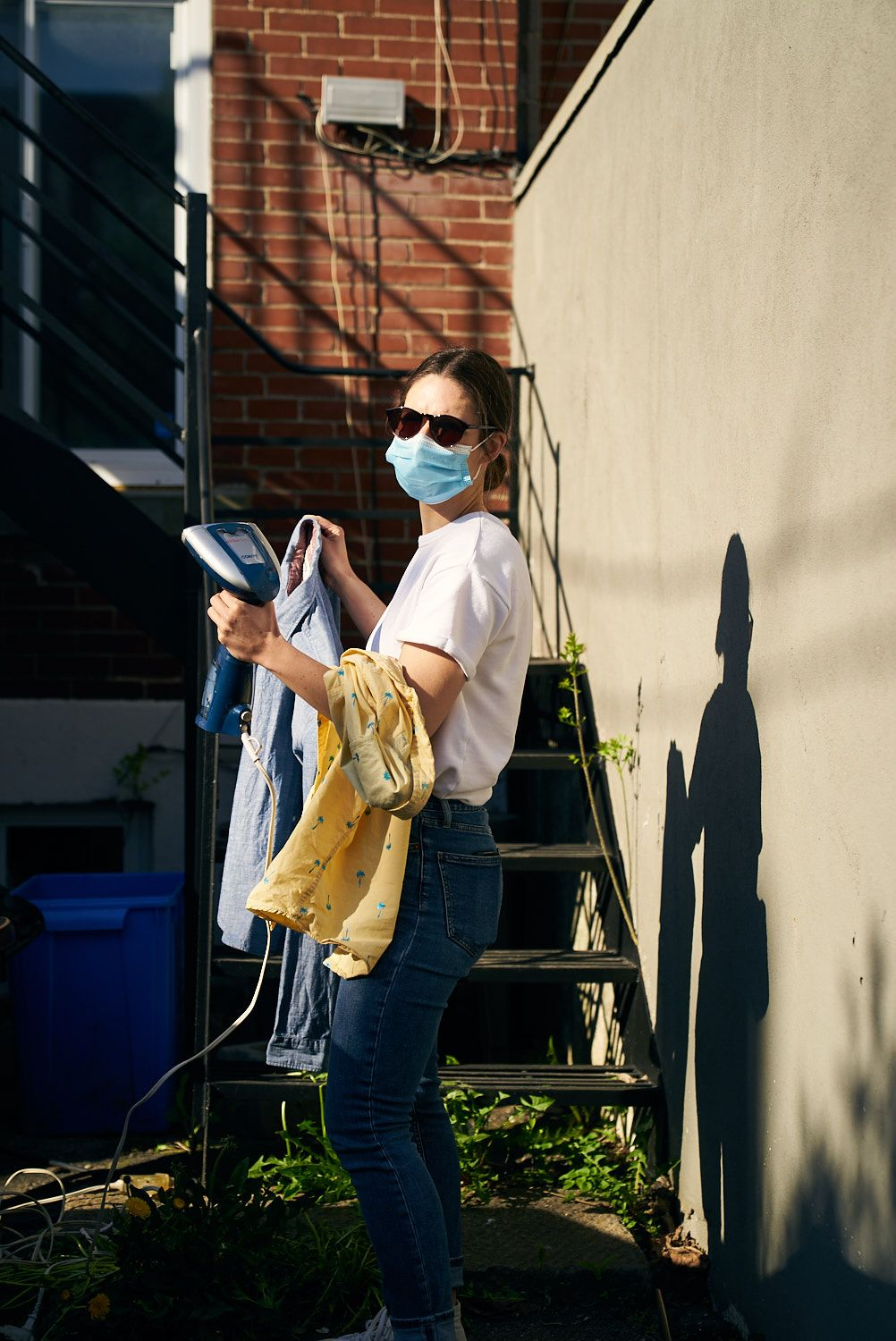 Consulat's Martine Goyette steaming clothes while wearing surgical mask for photoshoot of Bruno Florin for Belle Gueule