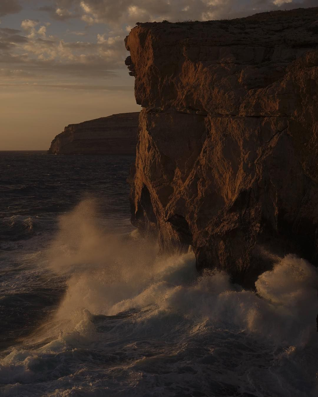 cliff above the ocean by Maxyme G Delisle