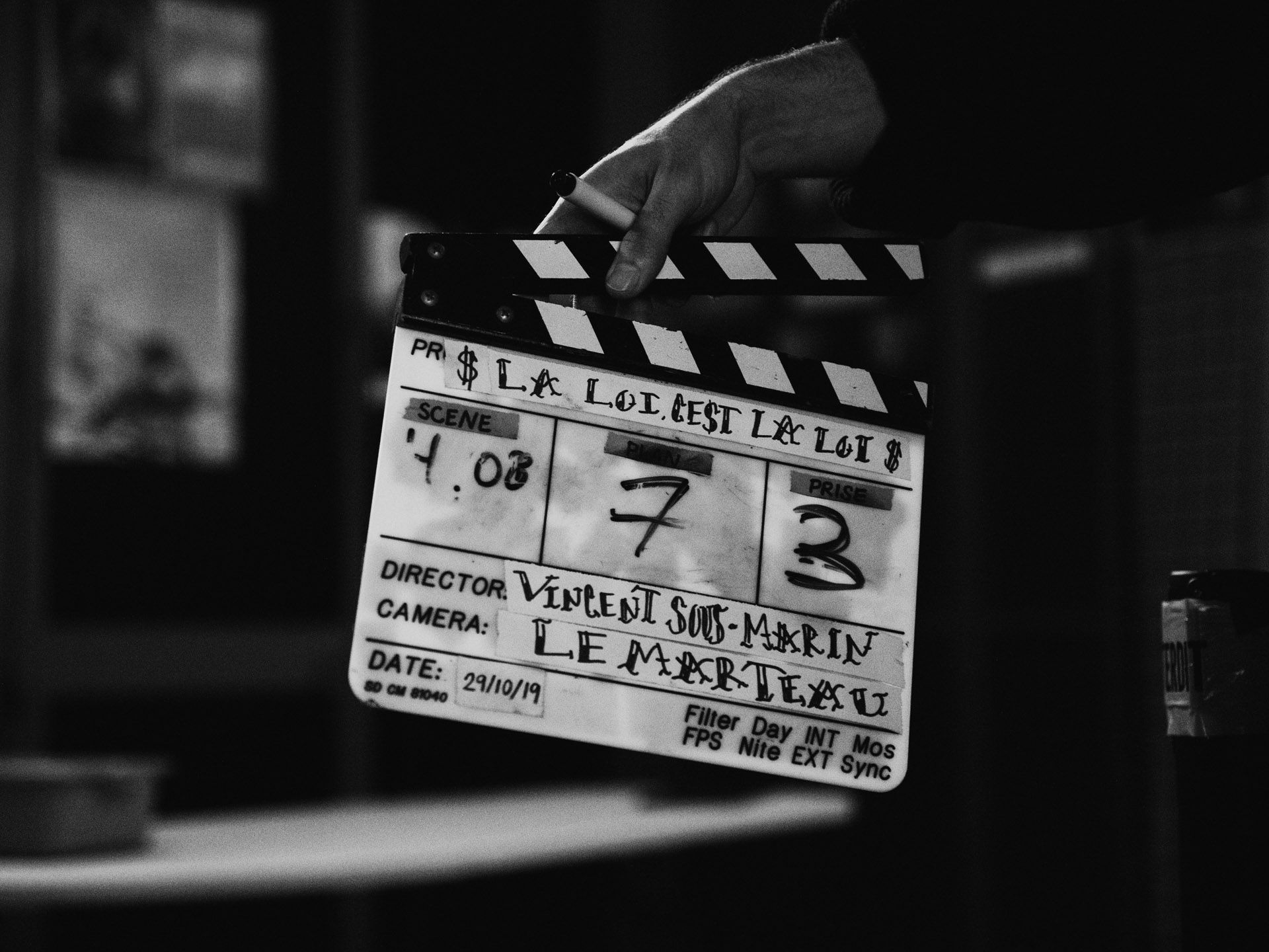 cinema clap with names of Vincent Ruel-Cote and Marco Gilbert from Les Gamins for TV series La Loi C'est La Loi shooting