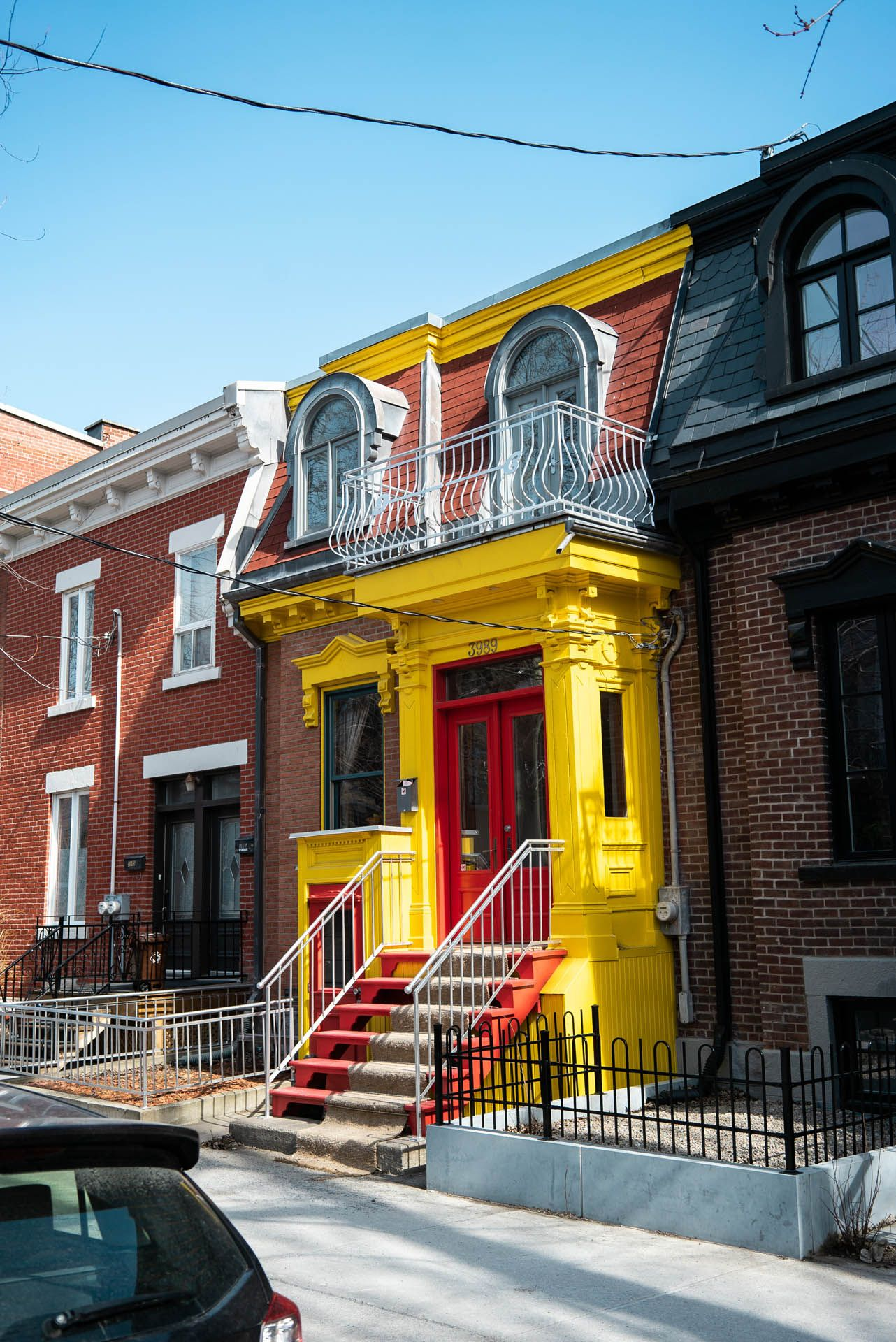 cute yellow typical montreal house by Bruno Florin