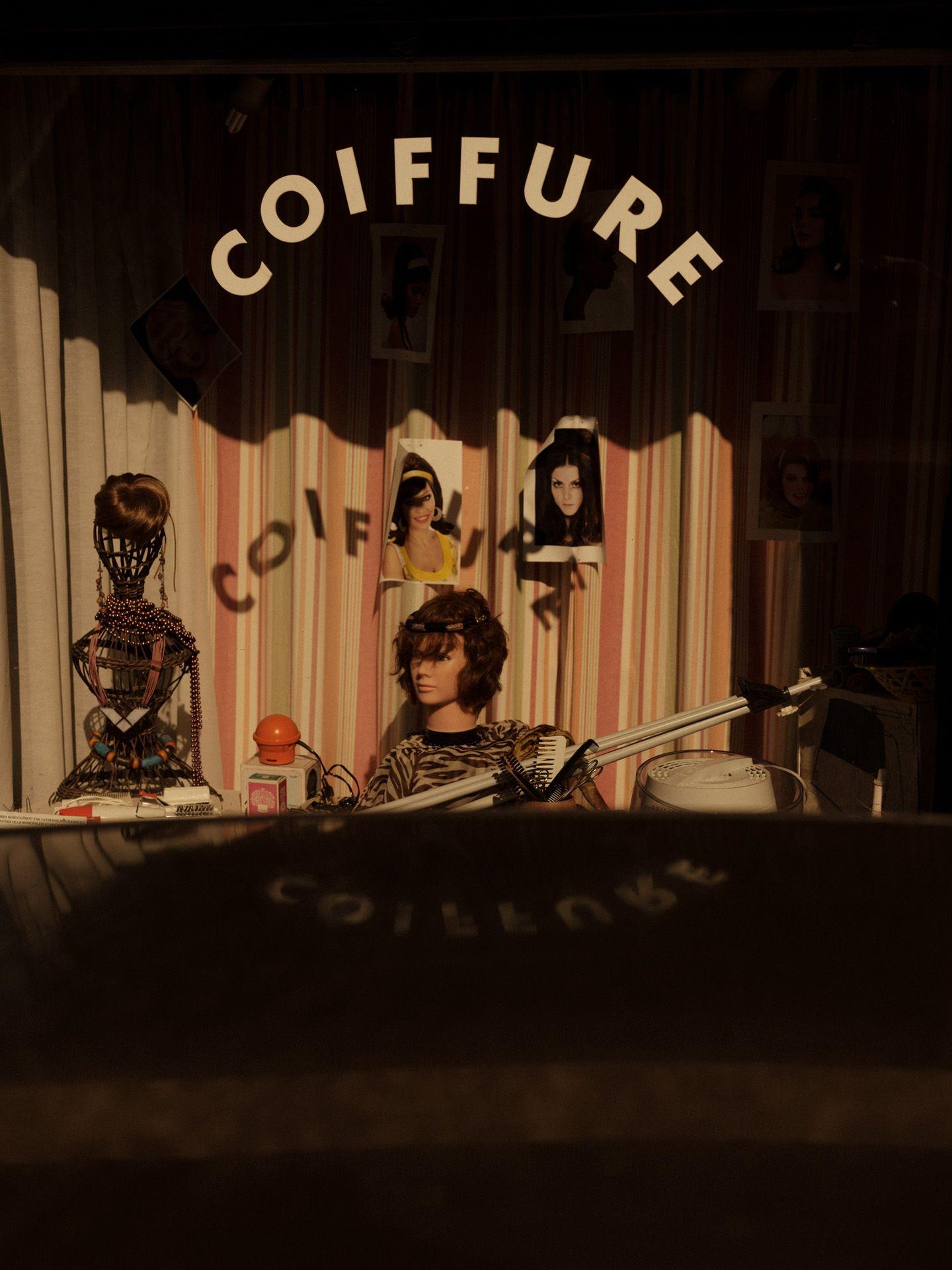 hairdresser shop window by Alexi Hobbs in Auvergne for Reflets de France
