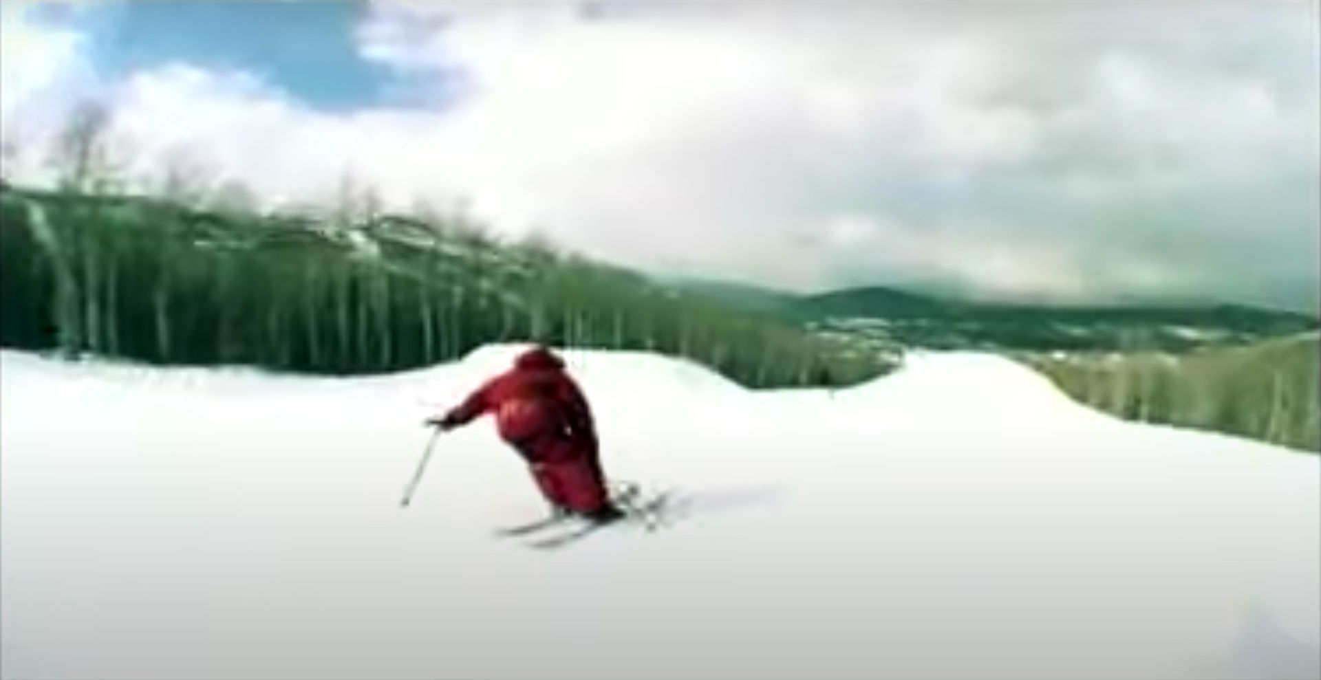 man in skis going down snowy slope in short film Exact Science by Mickael Deschenaux
