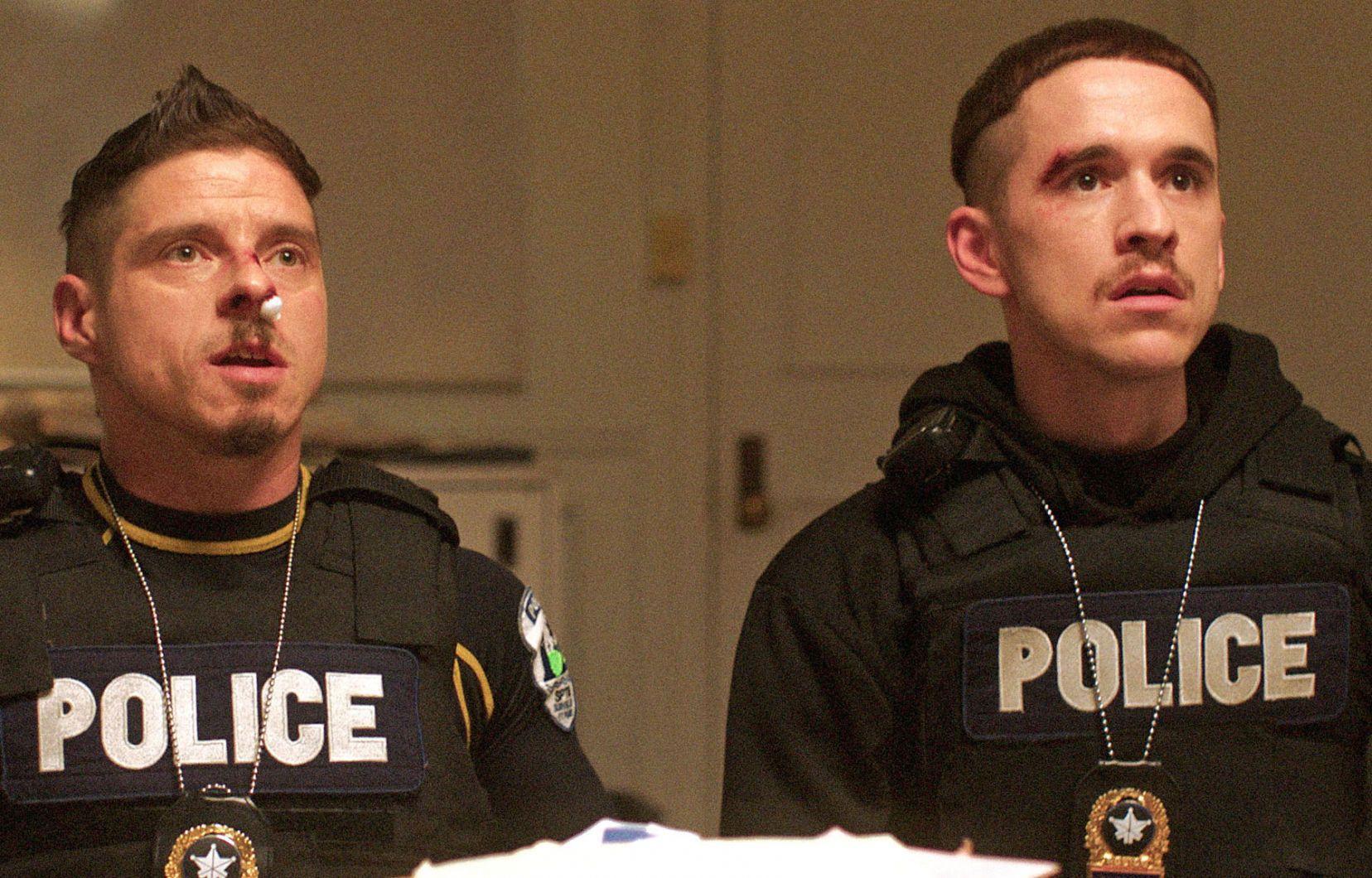actors Hugolin Chevrette-Landesque and Emile Schneider dressed as cops for TV series La Loi C'est La Loi filmed by Les Gamins for TV5 Unis