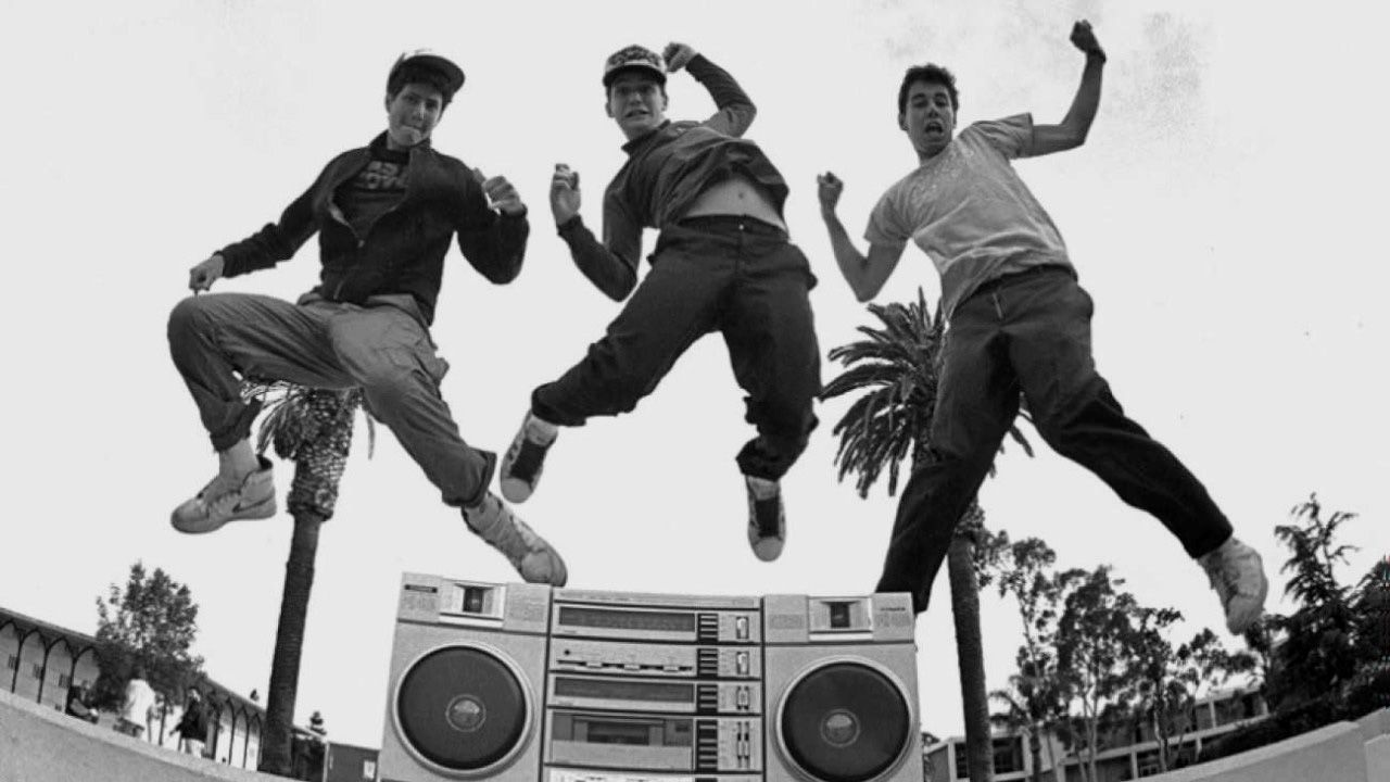 Beastie Boys group members jumping in the air in black and white